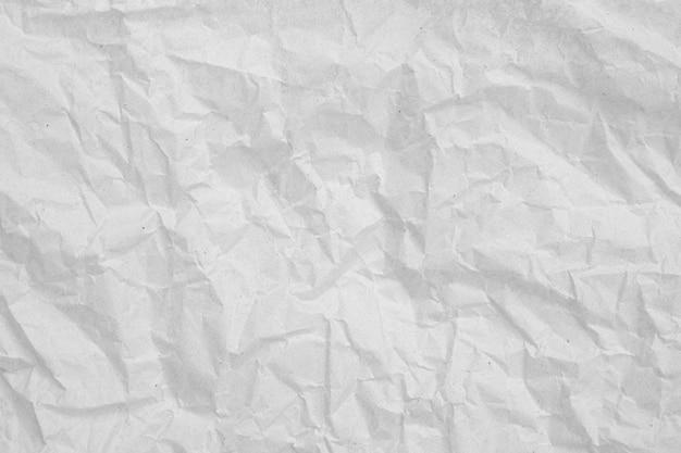 Grijze verfrommelde papier lege achtergrond. textuur van grijs gevouwen papier