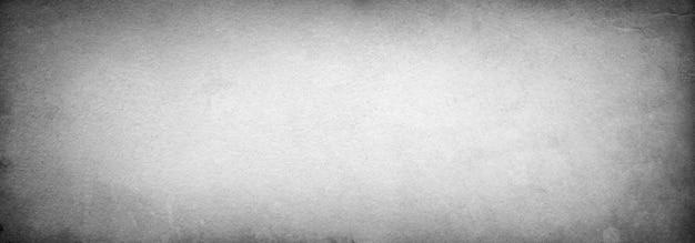 Grijze vintage grunge achtergrond banner ontwerp met kopie ruimte en ruimte voor tekst, oud papier textuur