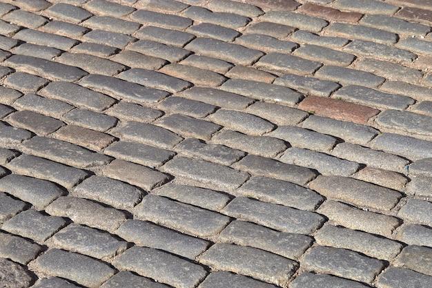 Grijze vintage stenen bestrating weg textuur achtergrond