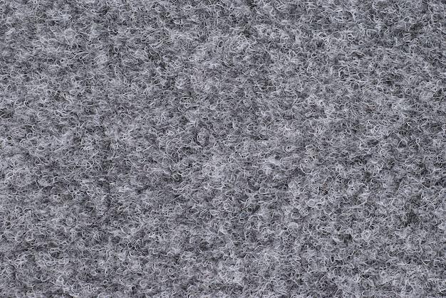 Grijze wollen stof kan worden gebruikt als ondergrond