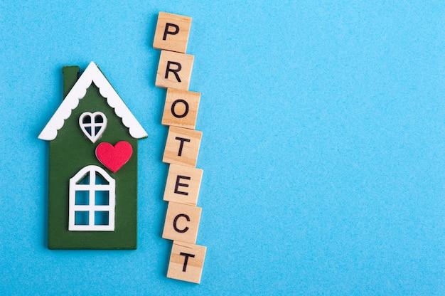 Groen blokhuis en bescherm teken
