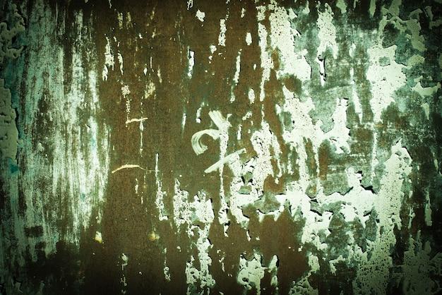 Groen, celadon, oranje, groen tij, roestige textuur. oude roestige muur achtergronden. ruwheid en scheuren.