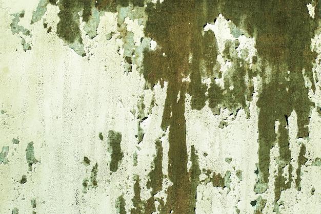 Groen, celadon, textuur. oude roestige muur achtergronden. ruwheid en scheuren.