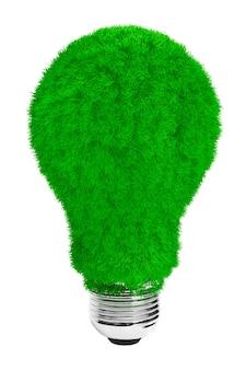 Groen energieconcept. gloeilamp met groen gras op een witte achtergrond