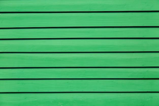 Groen gekleurde pastel houten achtergrond