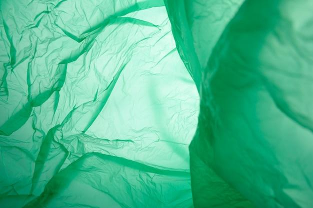Groen plastic vuilniszakmateriaal als achtergrond