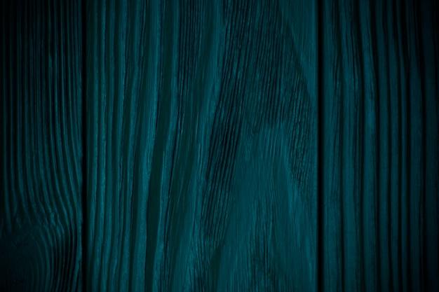Groene azuurblauwe gestructureerde houten achtergrond met zwart