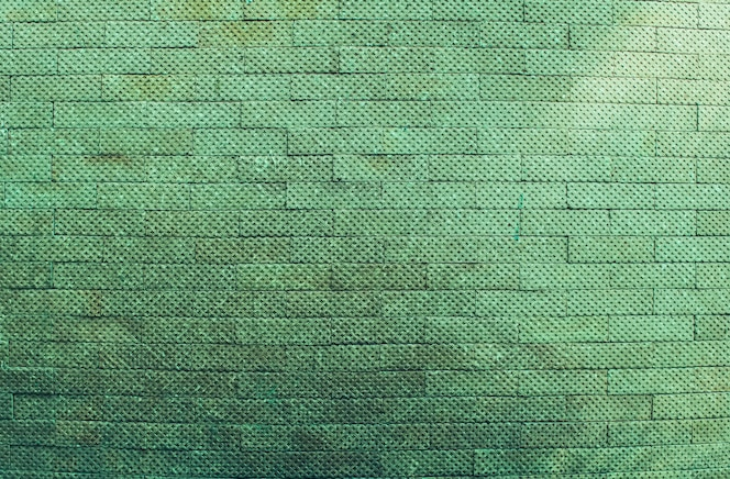 Groene bakstenen muur uitstekende en moderne textuur als achtergrond