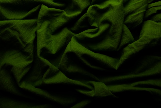 Groene doekachtergrond en textuur, van groene stoffensamenvatting gegroefd