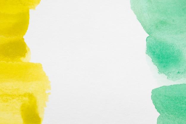 Groene en gele tinten handgeschilderde vlekken
