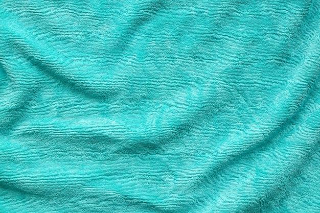 Groene handdoek stof textuur oppervlak close-up achtergrond