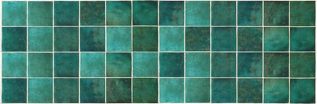 Groene keramische tegel achtergrond oude vintage keramische tegels in het groen om de keuken of badkamer te versieren...