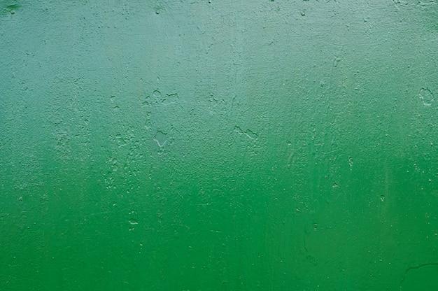 Groene metalen achtergrond. gegoten verf. metalen textuur