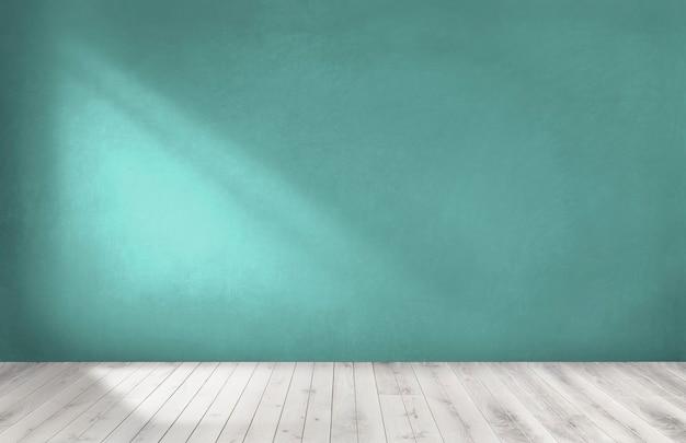 Groene muur in een lege ruimte met een houten vloer