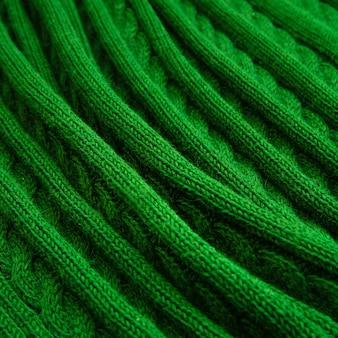 Groene plaid, gebreide pigtail.