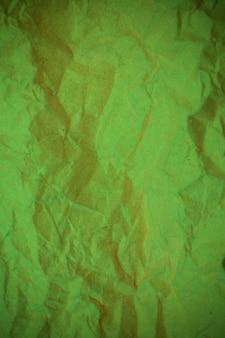 Groene verfrommeld papier achtergrond.