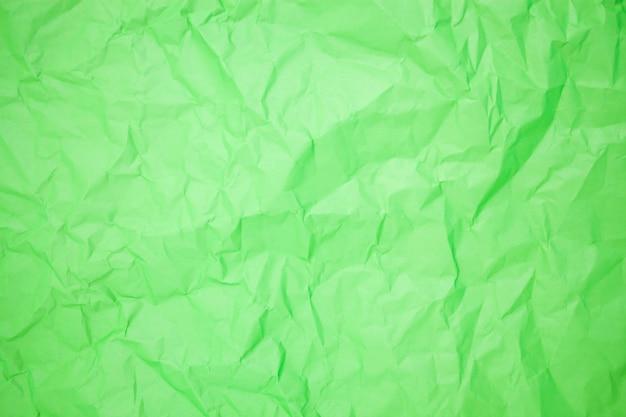 Groene verfrommeld papier achtergrondstructuur
