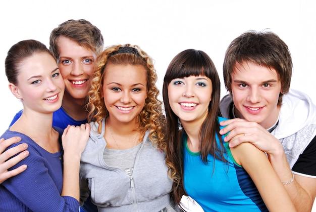 Groep aantrekkelijke jonge volwassen mensen - geïsoleerd op wit