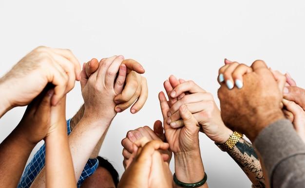Groep diverse mensen handen samen teamwork samenwerking