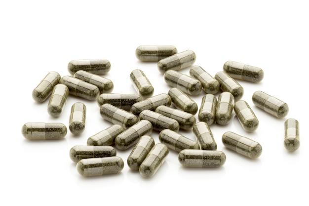 Groep donkergroene capsules geïsoleerd