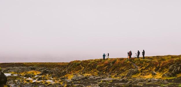 Groep fotografen op een berg