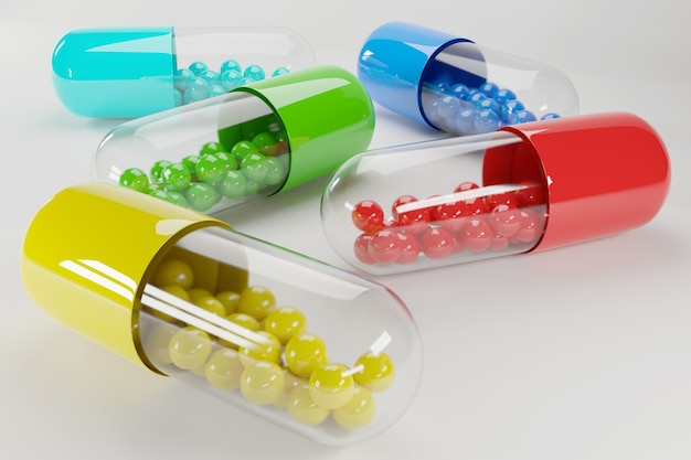 Groep transparant gekleurde medicijncapsules of pillen met inhoud gekleurde ballen. vitaminen en voeding slecht.