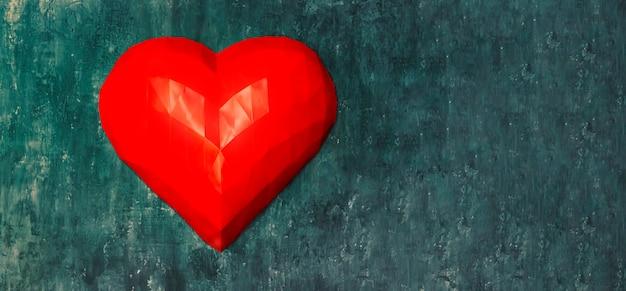Groot volumetrisch rood hart in de origamitechniek op een muur in de kleur van het jaar panton