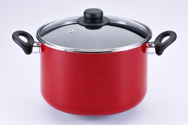 Grote rode pot met glazen deksel