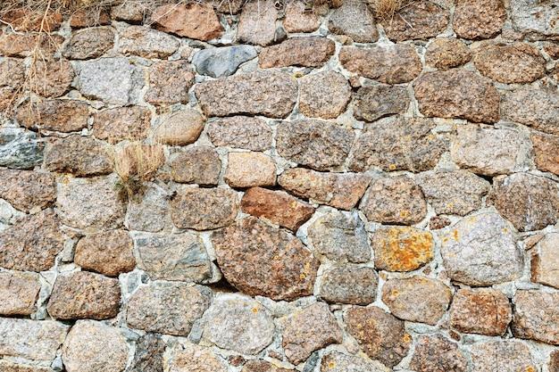 Grote stenen muur achtergrond. oude muur van het bouwen van stenen.