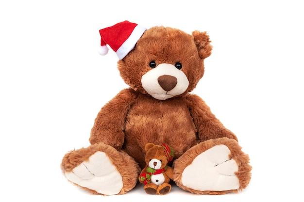 Grote teddybeer en kleine beer in kerstmutsen