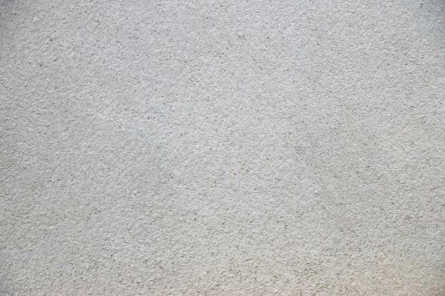 Grunge abstracte textuur als achtergrond witte betonnen muur