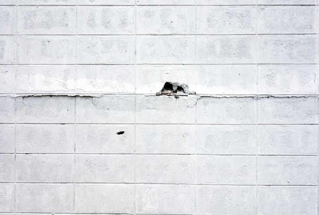Grunge, crack white brick-blokmuurtextuur, achtergrond