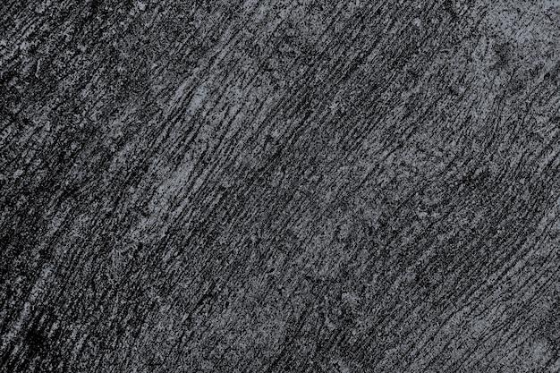 Grunge gekrast zwart beton getextureerde achtergrond