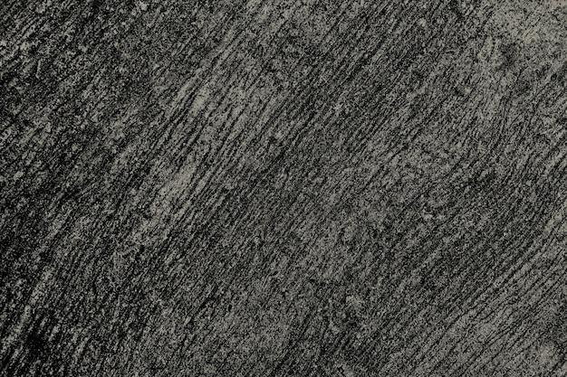 Grunge gekrast zwart en goud beton getextureerde achtergrond