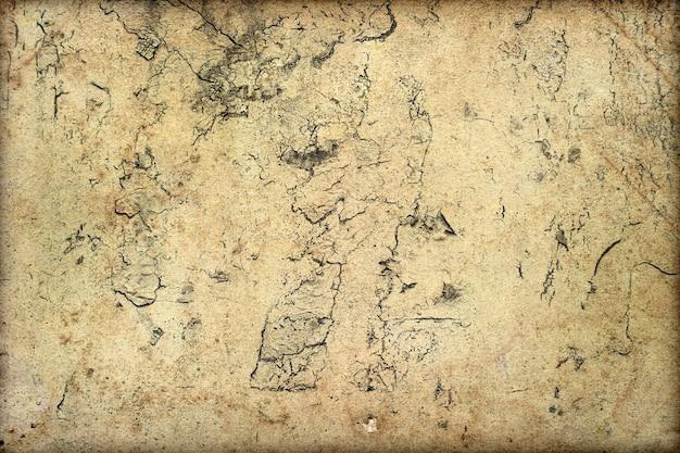 Grunge muur achtergrond. abstracte verweerde textuur met scheuren, vlekken, krassen, stof