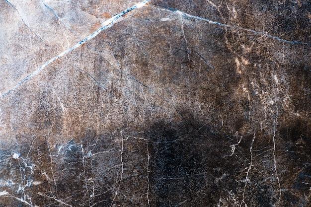 Grunge roestige gekrast stenen muur oppervlaktetextuur achtergrond.