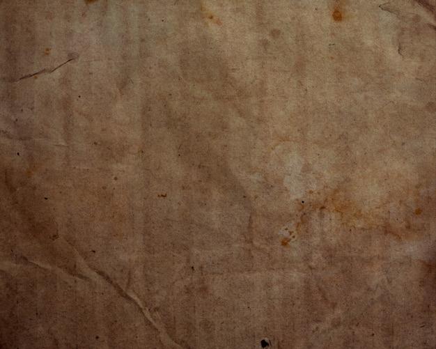 Grunge stijl papier textuur achtergrond met vlekken en vouwen