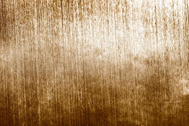 Grunge vervaagde gouden getextureerde achtergrond