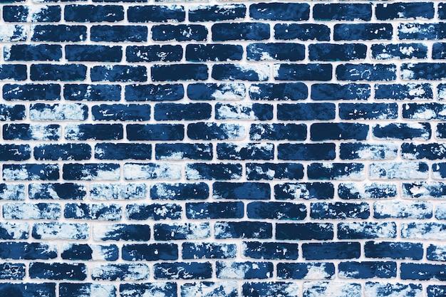 Grungeachtergrond van donkere klassieke blauwe bakstenen muur