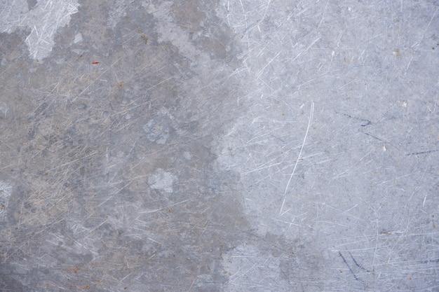 Grungestof en gekraste metaaltextuur als achtergrond