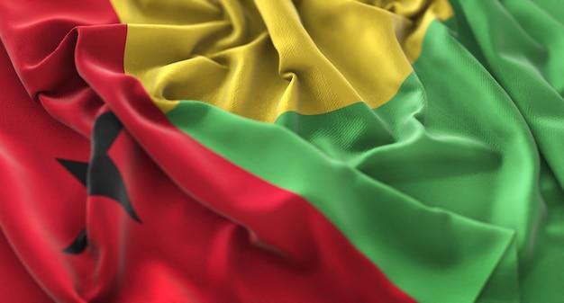 Guinea-bissau flag ruffled prachtig wave macro close-up shot