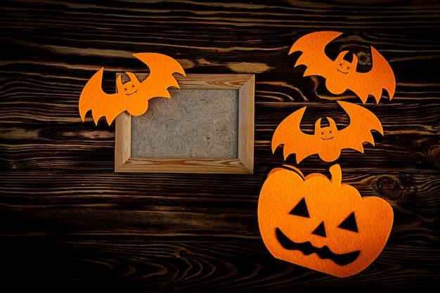 Halloween-achtergrond met knuppels, pompoenen. halloween-vakantieachtergrond.