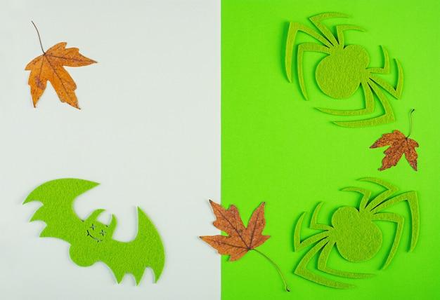 Halloween-achtergrond met spinnen en knuppels. halloween-vakantieachtergrond.