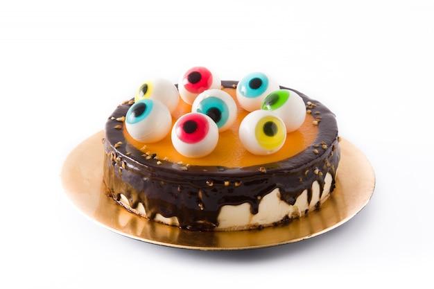 Halloween-cake met de decoratie van suikergoedogen op wit wordt geïsoleerd dat.
