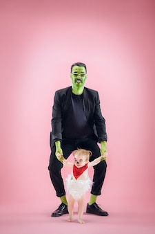 Halloween family happy couple in halloween costume and makeup bloody-thema