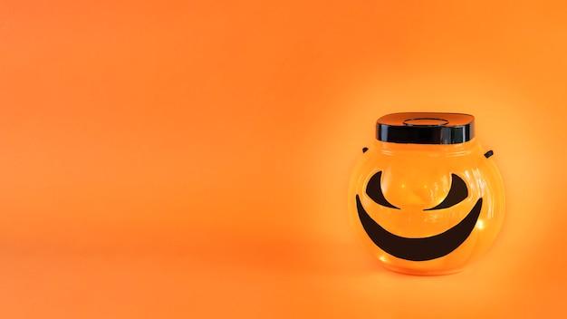 Halloween jacko lantern trick or treat bowl met lampjes op oranje achtergrond