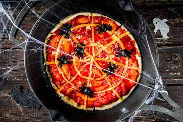 Halloween spiderweb pizza