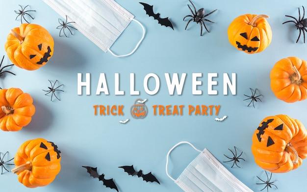 Halloween-versieringen gemaakt van pompoenpapieren vleermuizen en chirurgisch gezichtsmasker