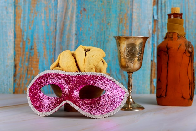 Hamans oren cookies noisemaker en masker voor purim viering joodse carnaval vakantie