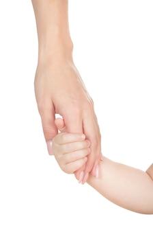 Hand aan een kind op wit wordt geïsoleerd dat